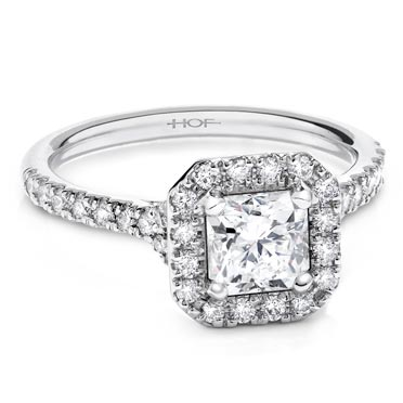 Halo - A halo ring features a center diamond surrounded by a circle of smaller diamonds. A bold style that stands out in a stack.