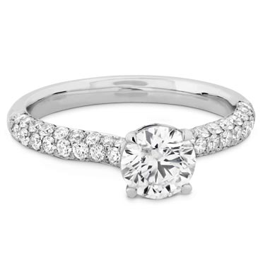 """Pave Pave - (pronounced pah-vay) is a French word that means """"paved."""" Rings with pave bands look like they've been paved with diamonds—there is little visible metal, meaning maximum visible sparkle"""